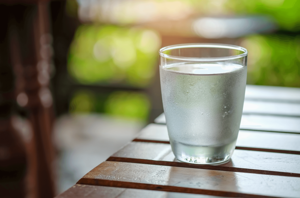 A glass of cold water on a table