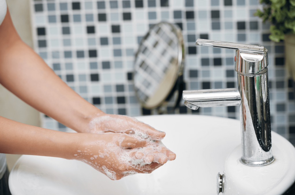 Washing hands with warm water and soap