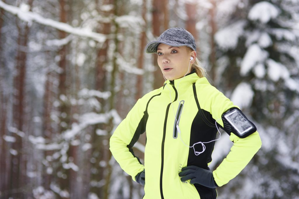 Woman dressed in active gear in the snow