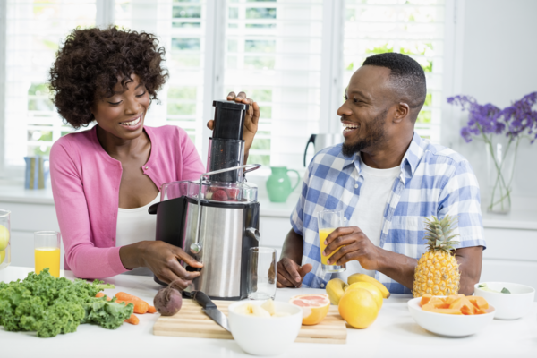 healthy couple making high fiber smoothie