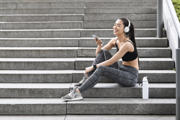 Sporty woman drinking water after training living healthy lifestyle